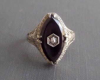 Art Deco Filigree Ring. White Gold, Onyx, Diamond Navette.