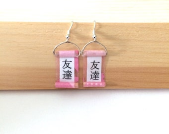 Friends in Japanese calligraphy on pink scroll earrings