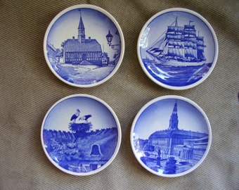 Four Royal Copenhagen plaquettes (mini plates) made in the1950s, 70-2010, 75-2010, 49-2010 & 84-2010