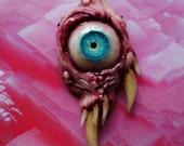 Big blue-green cyclops pendant