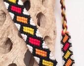 Friendship bracelet - tilted rectangles in red, orange, & yellow