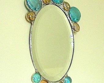 Oval primping mirror