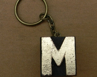 Vintage wooden letterpress keyring, gold leaf finish. Letter M.