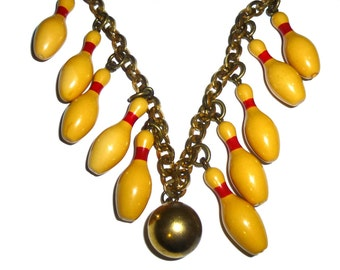 Vintage Bakelite Bowling Pin and Brass Necklace. All Original, Authentic and Tested. Circa 1940s USA. Brass Ball & Chain, 10 Bakelite Pins.