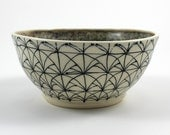 Small Multicolored Pottery Bowl with Geometric Patterns in Black
