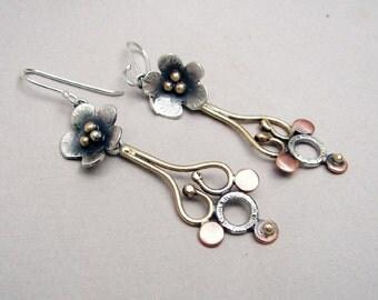 Long, flower chandelier earrings: sterling silver, brass and copper long, dangling, flower chandelier earrings