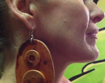 Beautiful lightweight wooden earrings. Inlaid wood on one side.