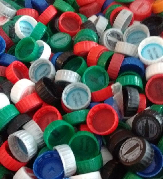 100 plastic soda bottle caps red blue green silver black