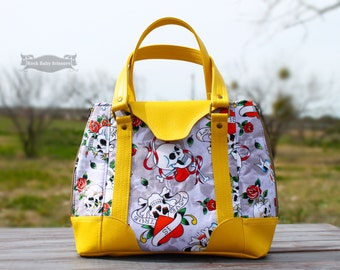 Skulls and Roses Harriet Expandable Tote with striped lining and yellow vinyl handles and accents