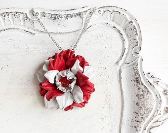 Red and white leather flower pendant