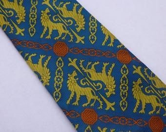 Vintage Beau Brummell Sapphire Blue and Pumpkin Orange Tie With Gold Lions And Fleur De Lis