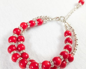Red coral and rhinestone double strand adjustable bracelet.