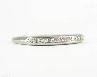 Vintage Diamond Platinum Wedding Ring, Mid Century 12 Stone Diamond Band by Orange Blossom Traub. Circa 1950s.