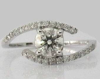 Diamond Twist Engagement Ring 14 kt White Gold 0.68 ct. total Diamonds IGL Report