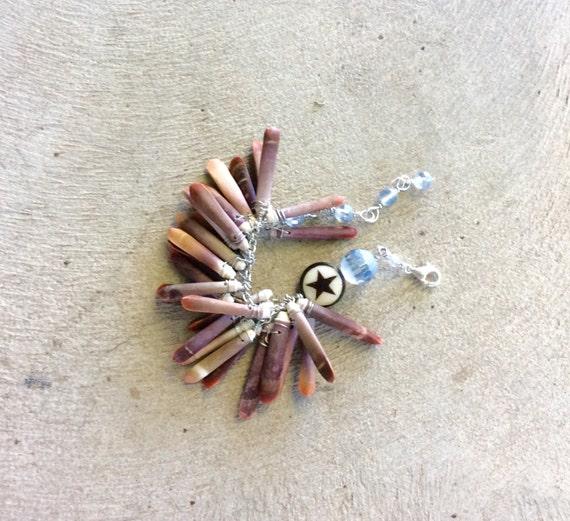 sea urchin bracelet. tribal beauty. wire wrapped coral sticks cross and swarovski. sterling silver clasp. handmade by uniquenecks