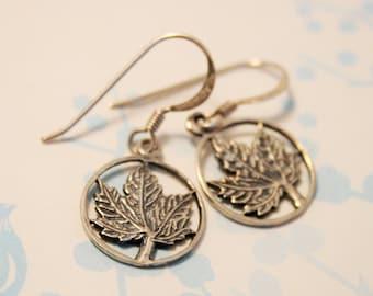 Sterling silver maple leaf earrings.