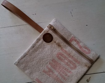 Wristlet made from vintage seed bag with vintage leather strap