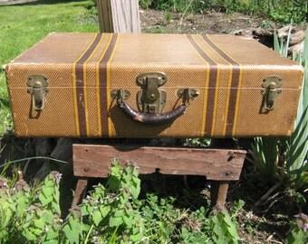 antique striped cardboard suitcase leather handle brass hardware man cave masculine movie prop