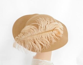 Vintage tilt hat with ostrich feather, 1960s camel wool