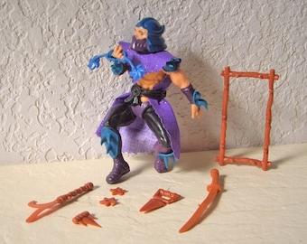 Vintage Teenage Mutant Ninja Turtle Action Figure Shredder, 1988 with all original weapons.
