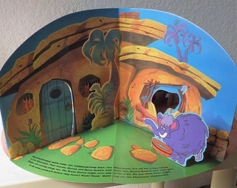 The Flintstones Playset with Punch Out Characters.  Pop-Up Carousel Book, 1994.  Like New.