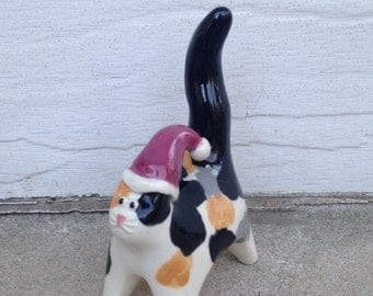 Calico cat with santa hat, ceramic mini sculpture