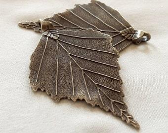 2 Antique Bronze Leaf Pendants, 70mm x 45mm, hole 3.5mm x 5mm. Package of 2 pendants.