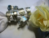 Assorted napkin rings handcrafted from antique silverware