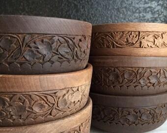 set of hand carved wooden bowls
