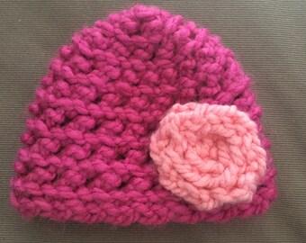 Pink newborn hat with light pink flower