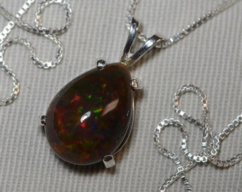 """Certified 6.31 Carat Solid Opal Pendant Appraised at 750.00 On 18"""" Necklace"""
