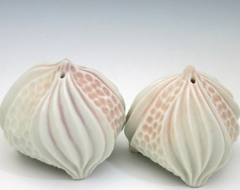 Warm white, peach & pink porcelain urchin hand carved salt and pepper shaker set