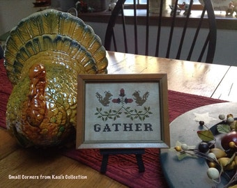 """Primitive """"gather"""" criss stitched sampler with stand"""