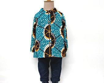 African wax print Girls tunic shirt, blue background with brown circles pattern