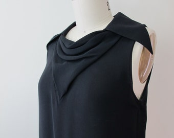CHANEL Black Silk Top with Gold Monogram Buttons