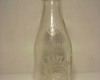 1927 S. Taylor Methuen, Mass., One Quart Size Milk Bottle, with an embossed Cows Head No. 2
