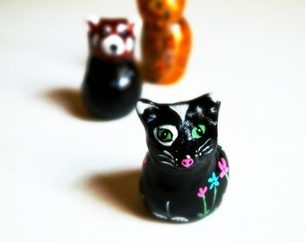 black cat animal totem, tuxedo cat, clay sculpture, flower painting, miniature clay animals, botanical print