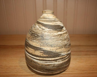 Amazing multicolored clay covered jar, lidded jar