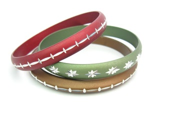 Metal Bracelets. Aluminum Bangles. Deep Red, Green, Brown. Anodized, Engraved Silver Accents. Set of 3. Vintage 1960s Retro. Beuhler Jewelry