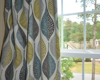 Made to order. One pair of window curtains, pleated top, no lining. Robert Allen Woodblock Leaf