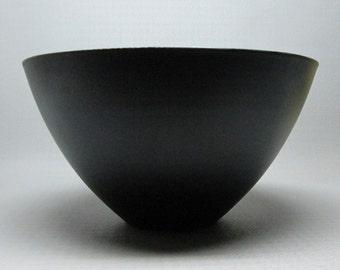 KRENIT bowl in black exterior white interior , no marks . Herbert Krenchel