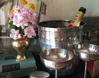 Champagne Bucket and Silver Champagne Glasses. Cordials. Entertain in style