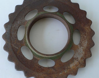 Vintage metal spacer, wheel, rustic, farm implement, industrial design from Diz Has Neat Stuff, string