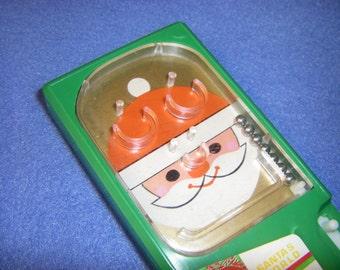 Vintage Santa's World Handheld Pin Ball Game