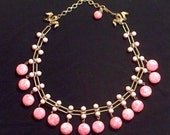 Vintage, 1950s signed Kramer choker necklace. Missing one strand. As is. Pink marble glass beads and gold tone chain