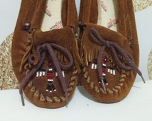 Vintage Beaded Leather Minnetonka Slip On Soft Sole Thunderbird Beaded Moccasins Womens Size 7. Made in USA hippy boho brown shoes slippers