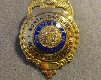 Obsolete North Carolina Department of Corrections Badge.