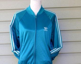 Retro 1970s authentic Adidas track jacket. Unisex size M/L