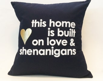 """18""""X18"""" This Home is Built on Love & Shenanigans Heart and Text Pillow Cover"""