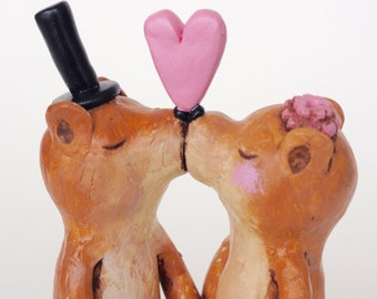 Kissing Otters in Love wedding cake topper